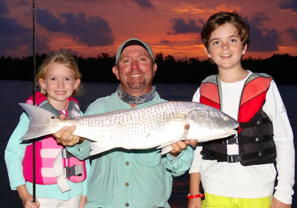 Kids fishing - sunset - redfish - key largo - 2012